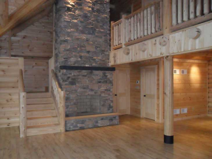 log home stairs and fireplace
