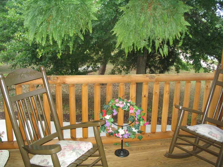 log home porch and log railing