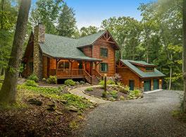 custom log cabin home kit with garage