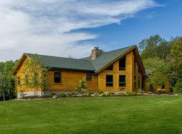 custom log home with prow